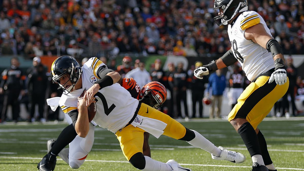 Pittsburgh Steelers quarterback Mason Rudolph (2) grounds the ball under pressure from...