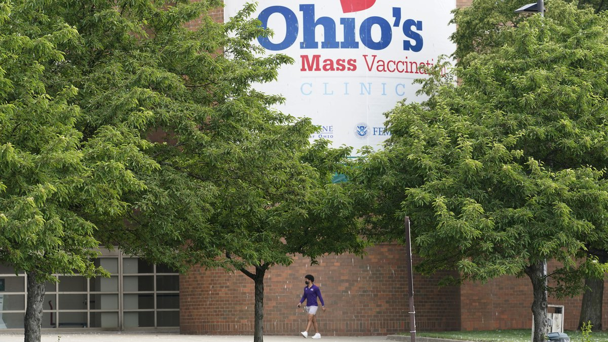 FILE - In this May 25, 2021, file photo, a man walks by the entrance for Ohio's COVID-19 mass...