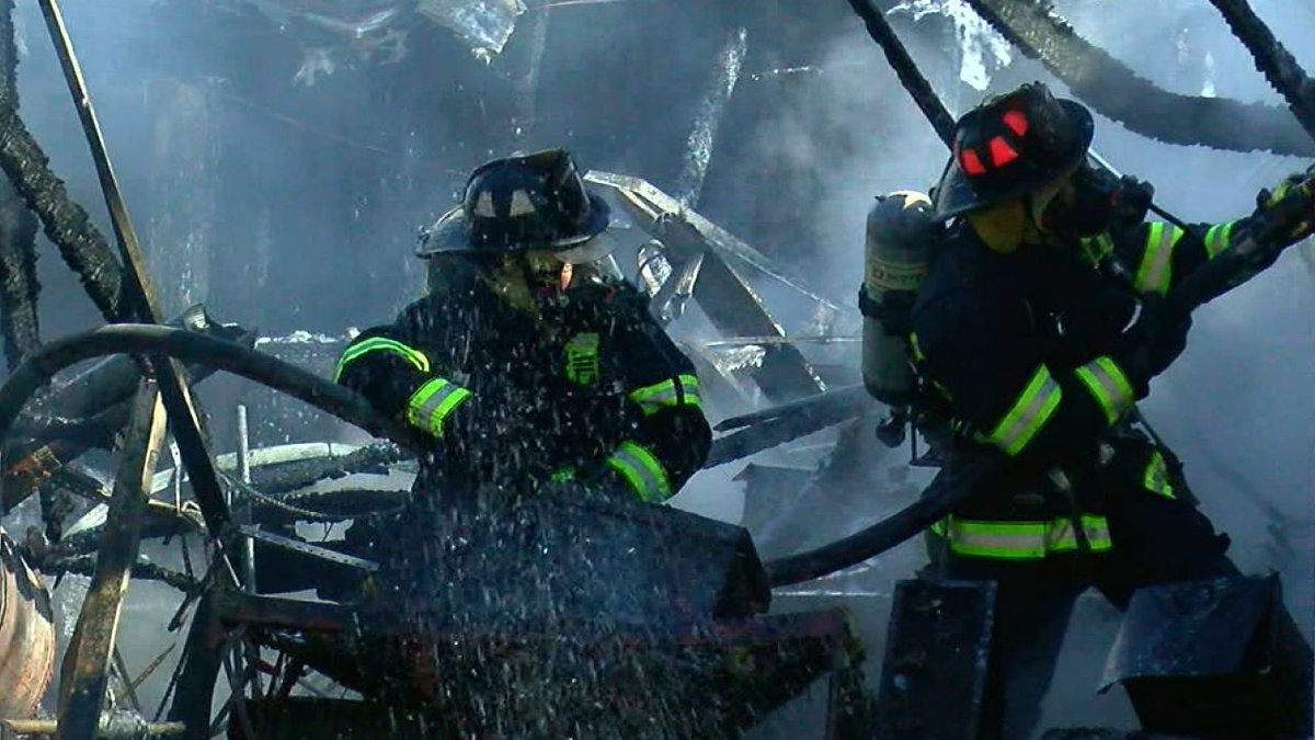 Jonesboro firefighters worked to contain fire from spreading to homes.