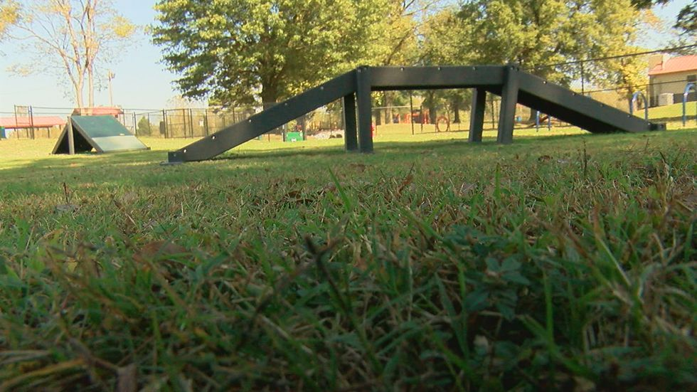 Harmon Park has play equipment for kids, sidewalks for adults to walk, and now the Bark Park...