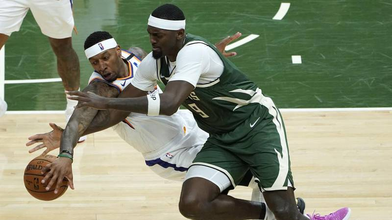 Phoenix Suns forward Torrey Craig (12) and Milwaukee Bucks center Bobby Portis (9) battle for...