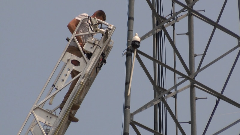 Stoddard County EMA Director Andrew Bohnert installs new weatherproof technology.