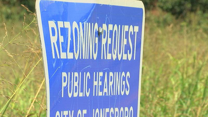 Rezone sign sits in the front part of the property