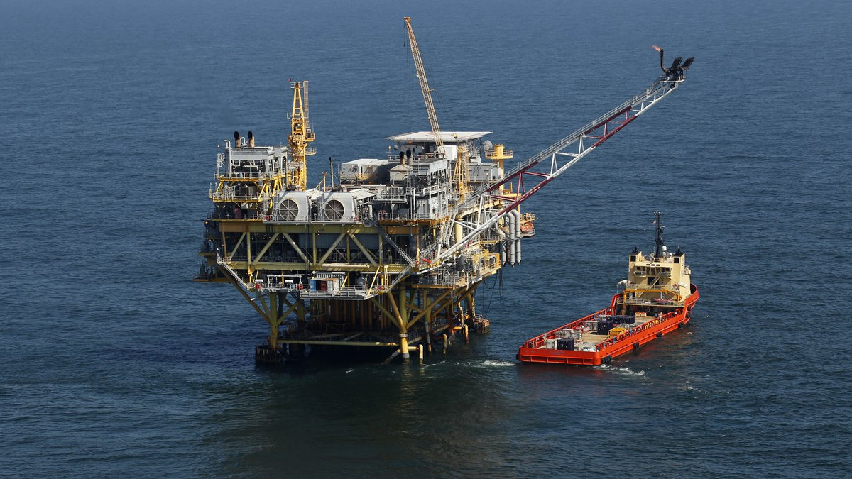 This file photo shows a rig and supply vessel April 10, 2011, off Louisiana's coast in the Gulf...