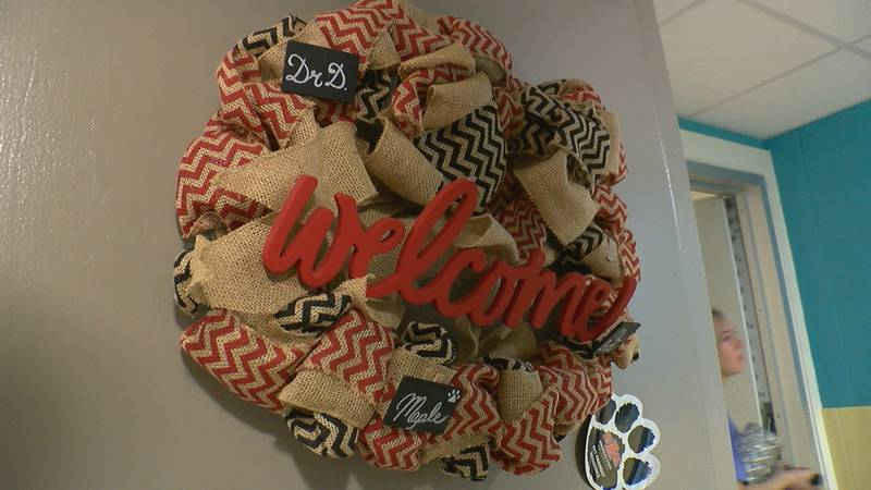 The welcome wreath on the door of Dr. Kelly Damphousse and his wife Beth Damphousse's temporary...
