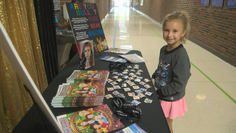 Eight-year-old Lily Sloan Burnette greeted students as they arrived Wednesday morning at Wynne...