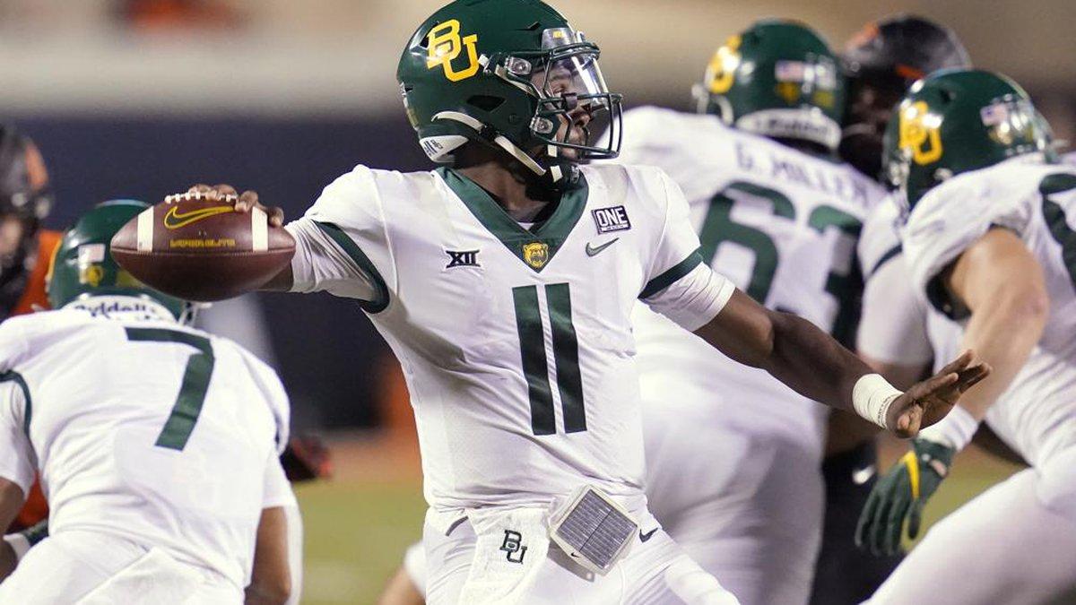 Baylor quarterback Gerry Bohanon (11) throws in the second half of an NCAA college football...
