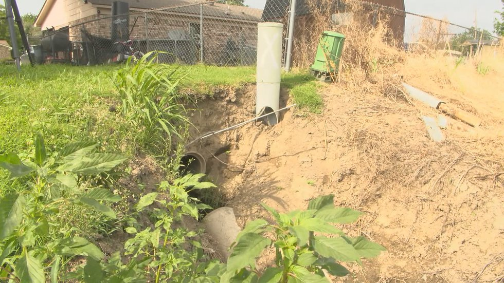 Residents say a hole formed along the ditch and caused a child to slip recently.