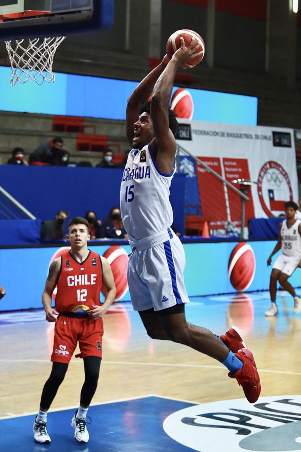 Arkansas State forward Norchad Omier throws it down for Nicaragua in FIBA World Cup Americas...