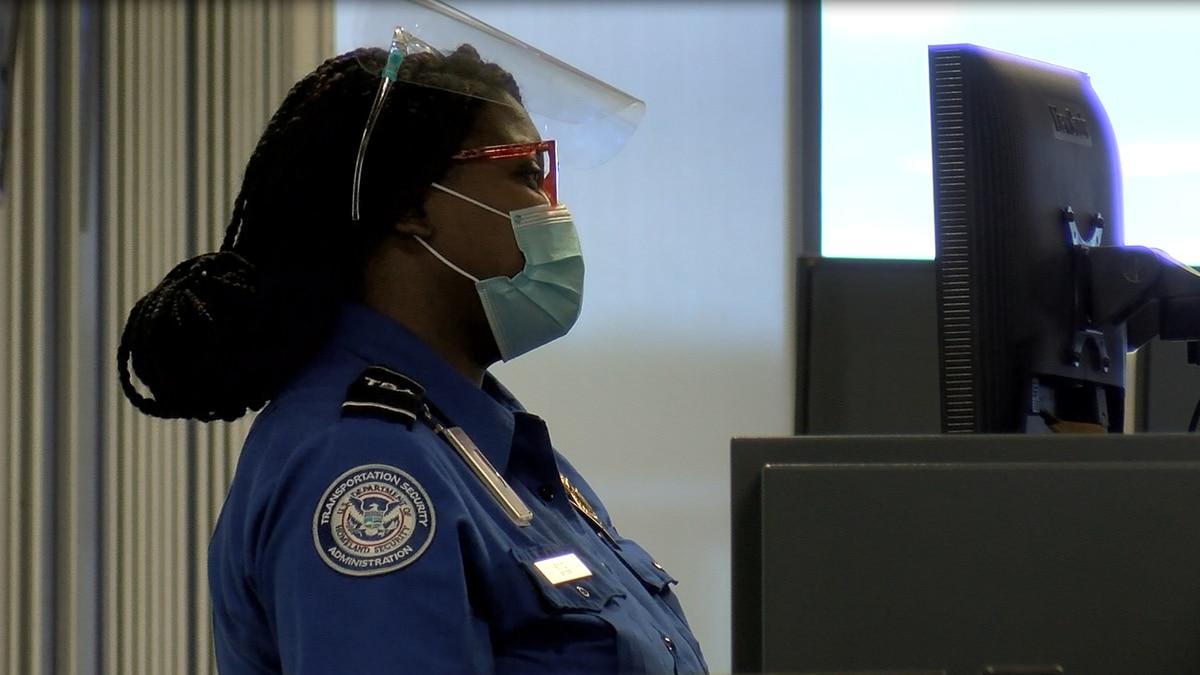 Masked TSA agent working at Evansville Regional Airport.