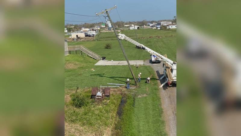 Crew members help restore power in Louisiana