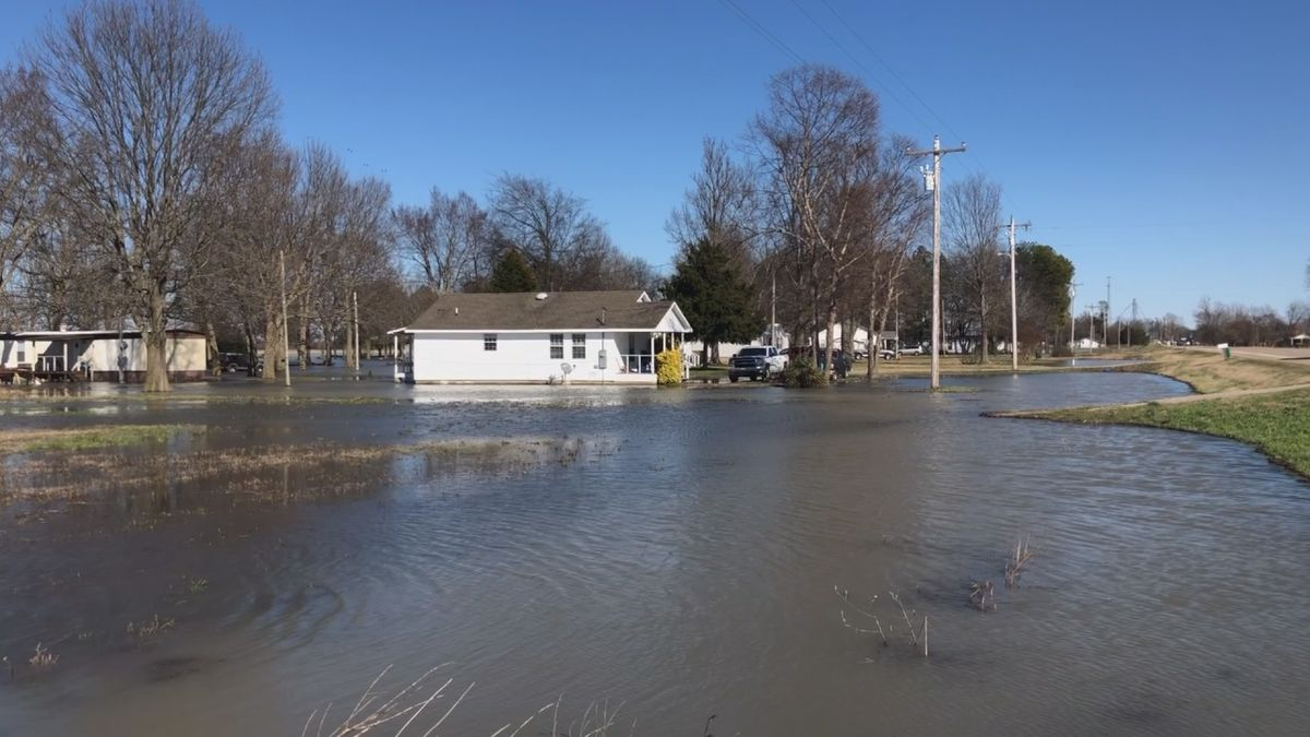 The Poinsett County Road department was busy trying to prevent waters from rising in Payneway...