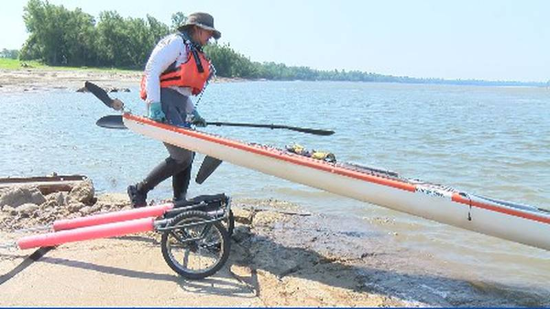 Traci Lynn Martin puts her boat into the river in Grand Tower heading towards Cape Girardeau.