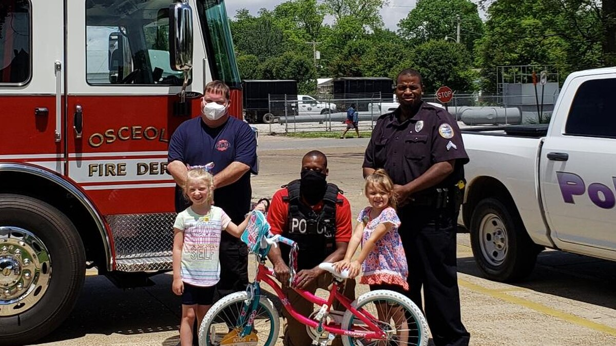An Osceola child received a new bicycle Thursday from Osceola police and firefighters, after...
