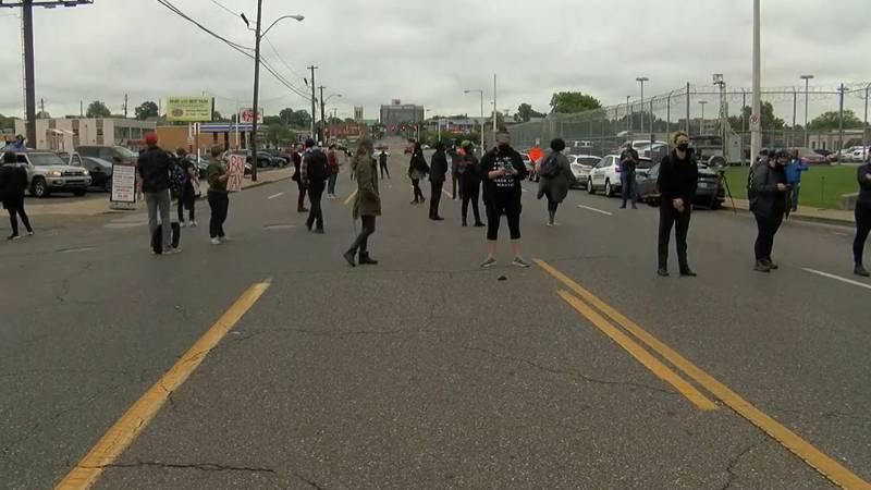 Protesters block Poplar Avenue in front of 201 Poplar Thursday, Sept. 24, 2020.