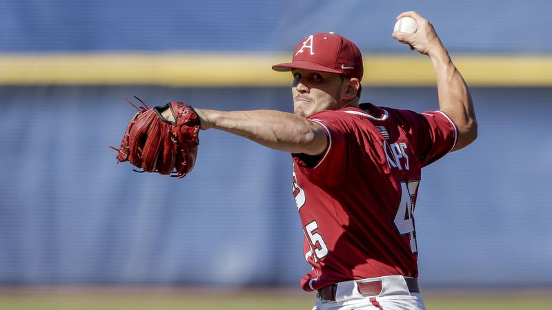 Arkansas pitcher Kevin Kopps pitches against Tennessee in the ninth inning of an NCAA college...
