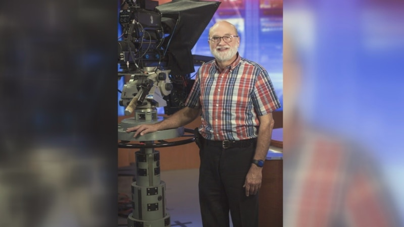 Gerald Erickson stands beside one of the many cameras he's worked on over the years.