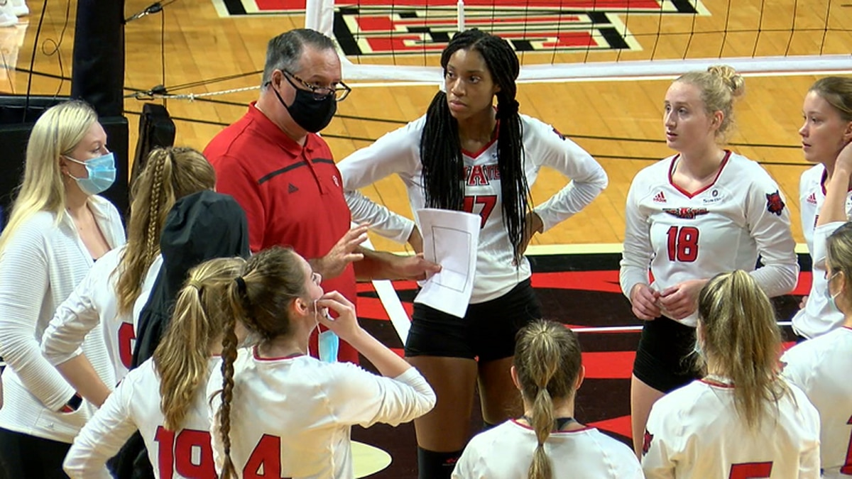 Arkansas State volleyball coach Santiago Restrepo talks to his team during a timeout.