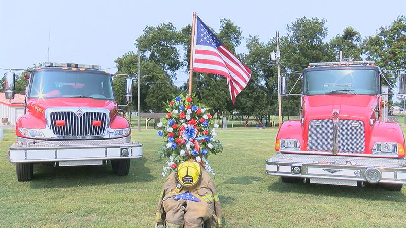 Two Tuckerman fire trucks back a wreath and firesuit to remember 9/11.