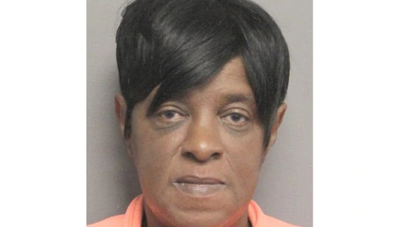 Michelle Jackson was booked into jail after allegedly beating a man with his own leg