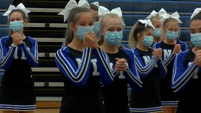Cheerleaders will be wearing masks this year to remain safe.