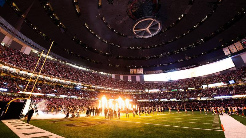 The Saints make their dramatic entrance onto the field at the Superdome before a game (Source:...