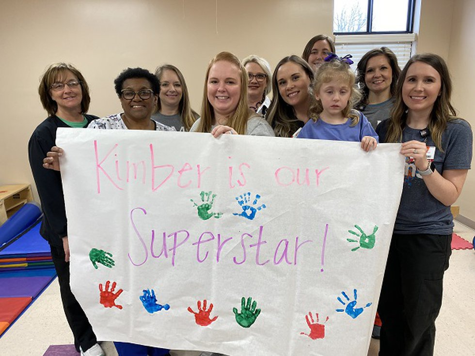 Staff at UAMS Kids First in Pocahontas made a poster wishing Kimber well on her telethon...