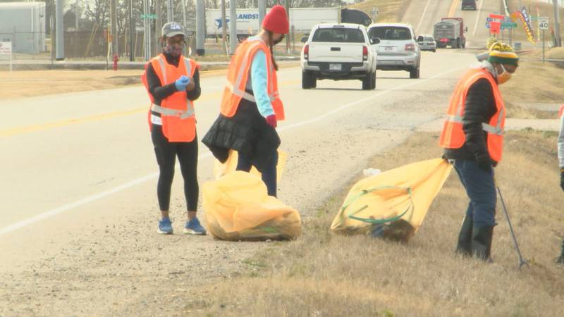 Group helps pick up trash on Dr. Martin Luther King, Jr. Drive.