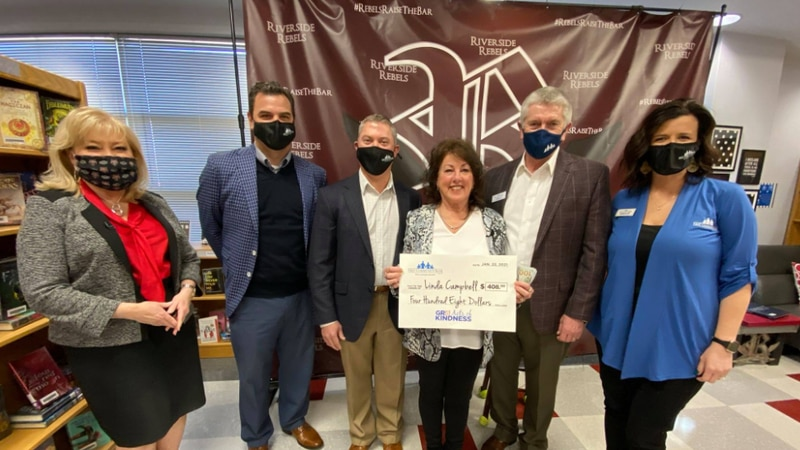 Linda Campbell is awarded a keepsake oversized check from First Community bank to keep after...