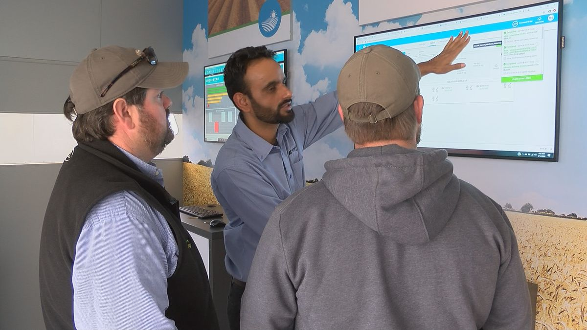Farmers talk about the latest technology available at the two day tech Roadshow in Bernie, Mo