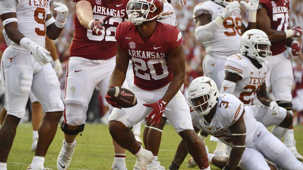 Arkansas running back Dominique Johnson (20) celebrates after scoring a touchdown against Texas...