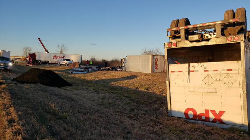 One semi is overturned in the median while another is overturned blocking one southbound lane....