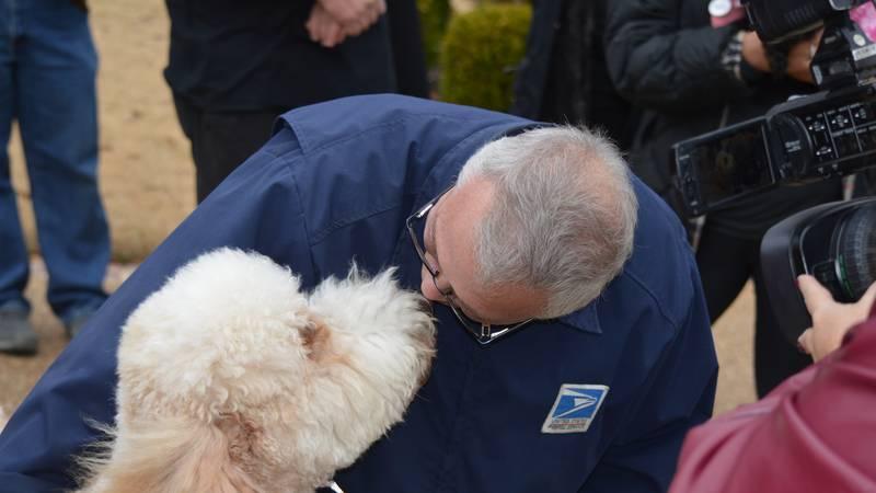 Neighborhood raises money to give mailman a dog