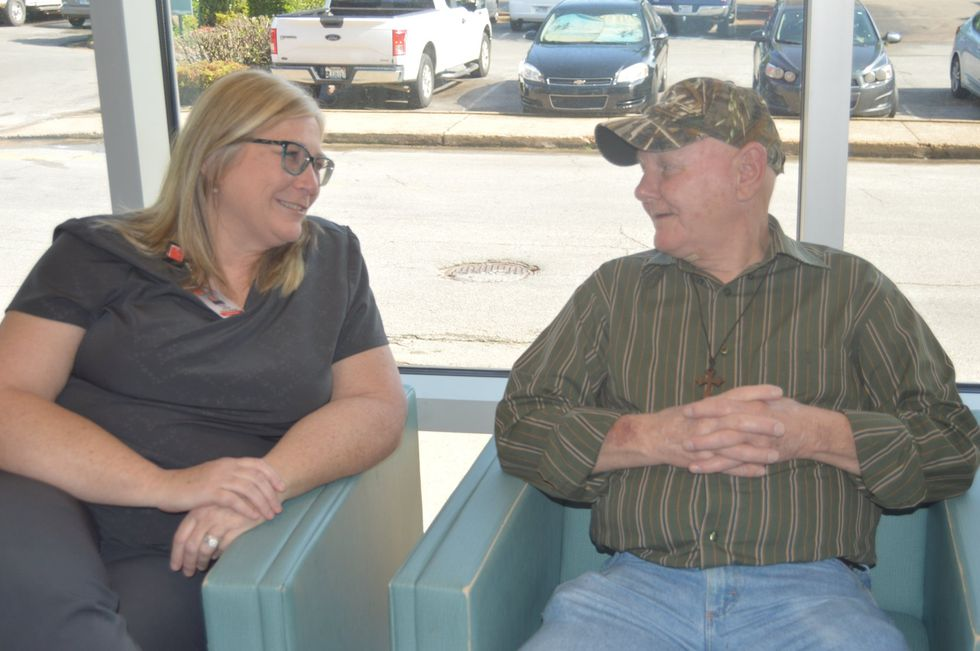 Angie Brady and Aubrey Cook talk recently. Brady is Cook's patient care navigator, helping Cook...