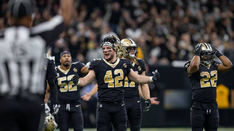 Saints players react to the referee's missed interference call.  (Source: Mark Legrange)