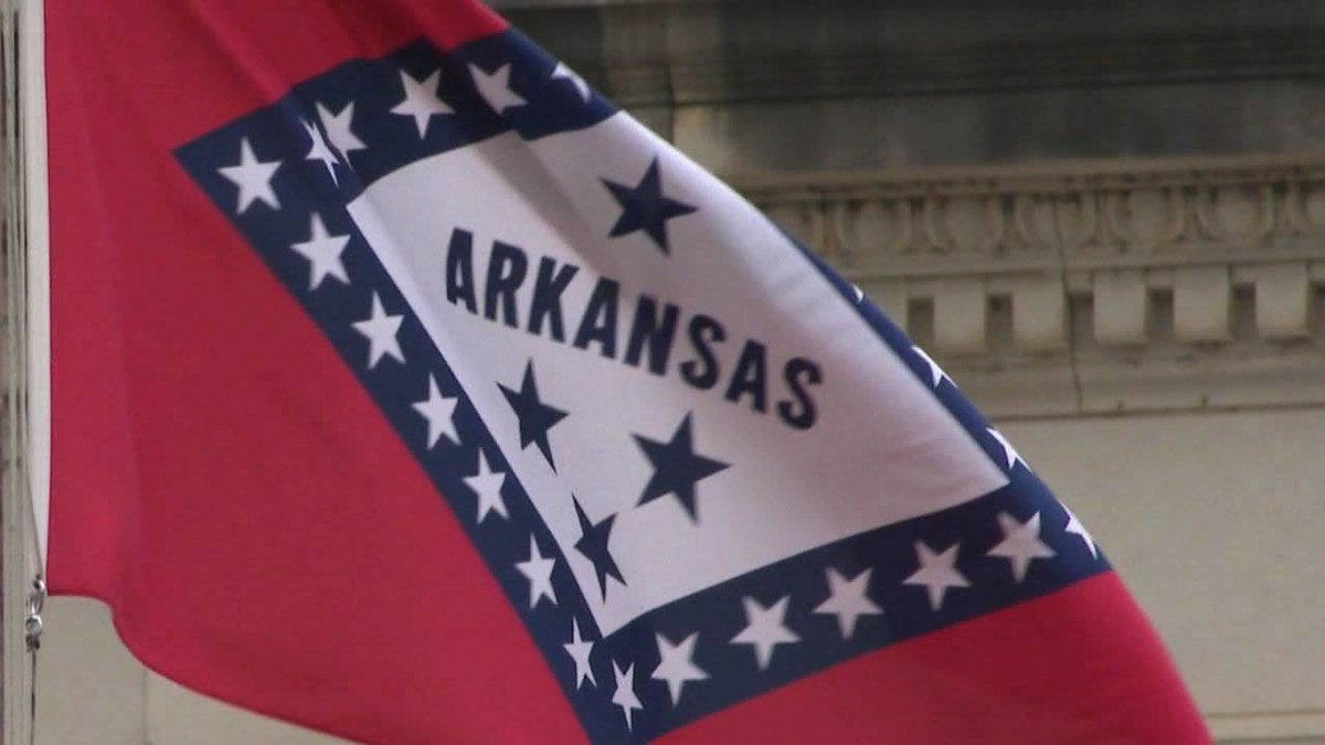 Arkansas state flag outside the state Capitol.