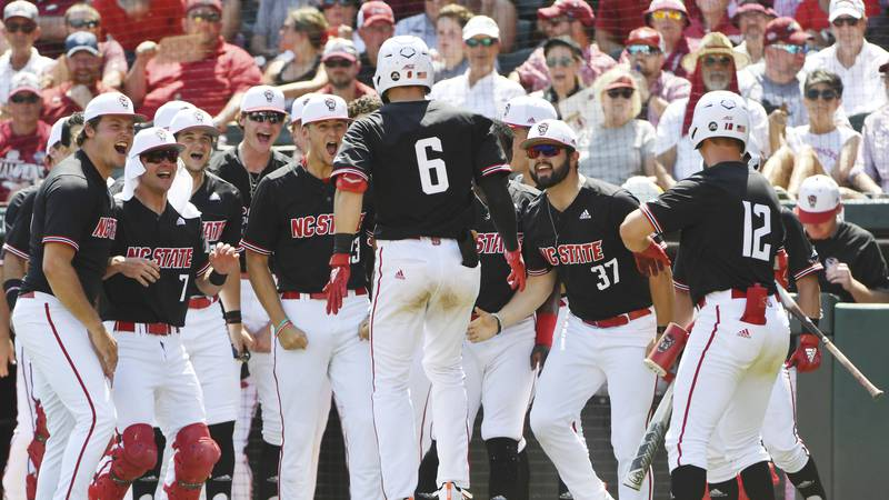 North Carolina State batter Vojtech Mensik (6) is greeted by teammates after hitting a home run...
