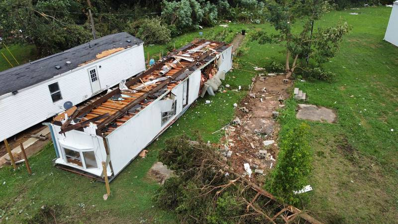 A mobile home was flipped over as an EF2 tornado made its way through Dexter, Mo. on Saturday...