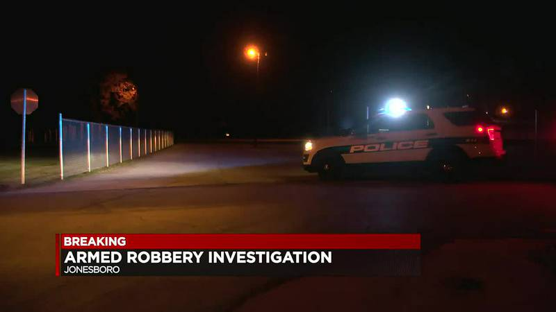 Jonesboro police are searching for two men suspected of robbing a woman at gunpoint in her...