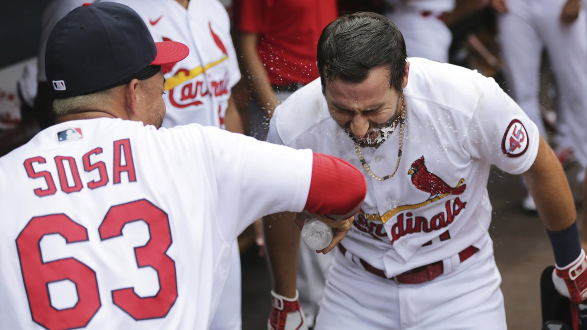 St. Louis Cardinals' Paul DeJong (11) gets a face full of water from Edmundo Sosa (63) as they ...