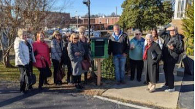 Several members of Chapter DG of P.E.O., including library director Sue Szostak (fourth from...