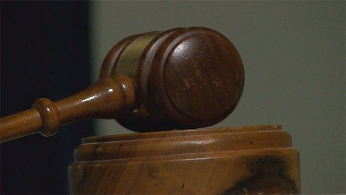 An Arkansas attorney says in a lawsuit that his contract with the state was terminated because...