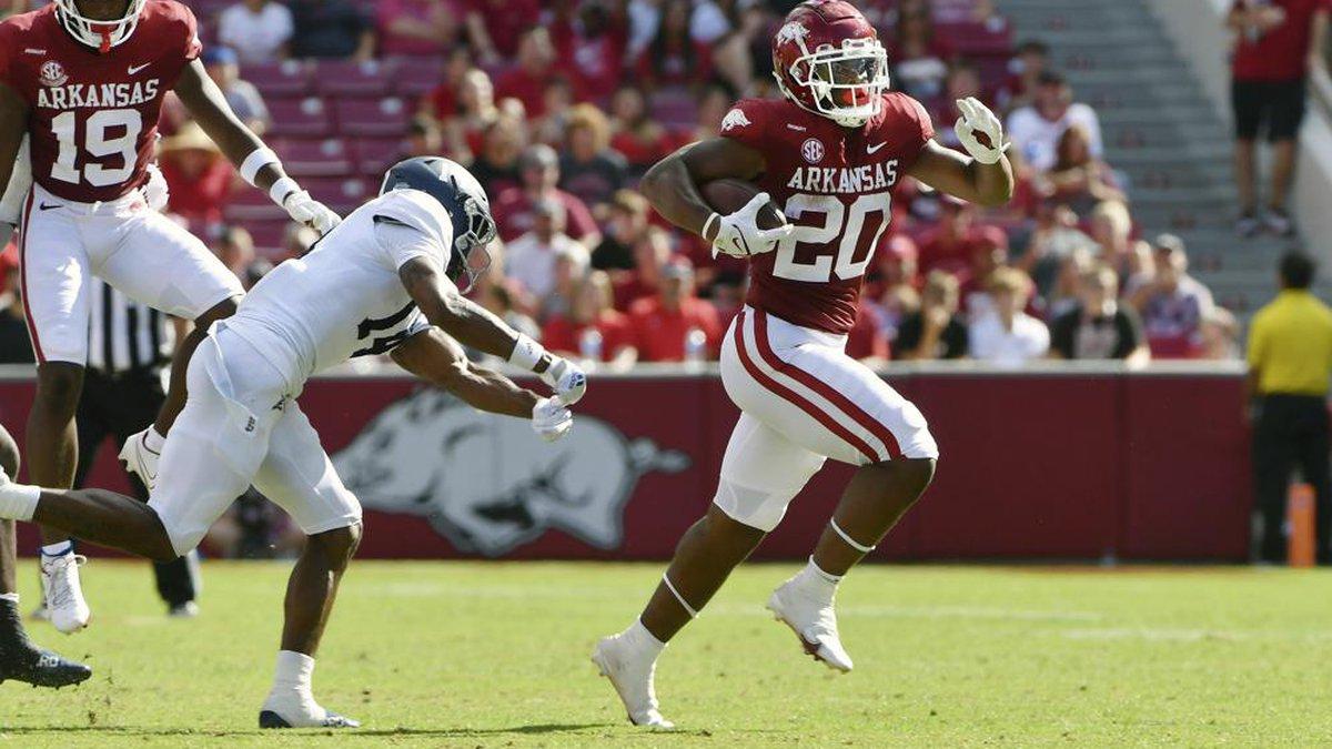Arkansas running back Dominique Johnson (20) slips past Georgia Southern corner back Darrell...