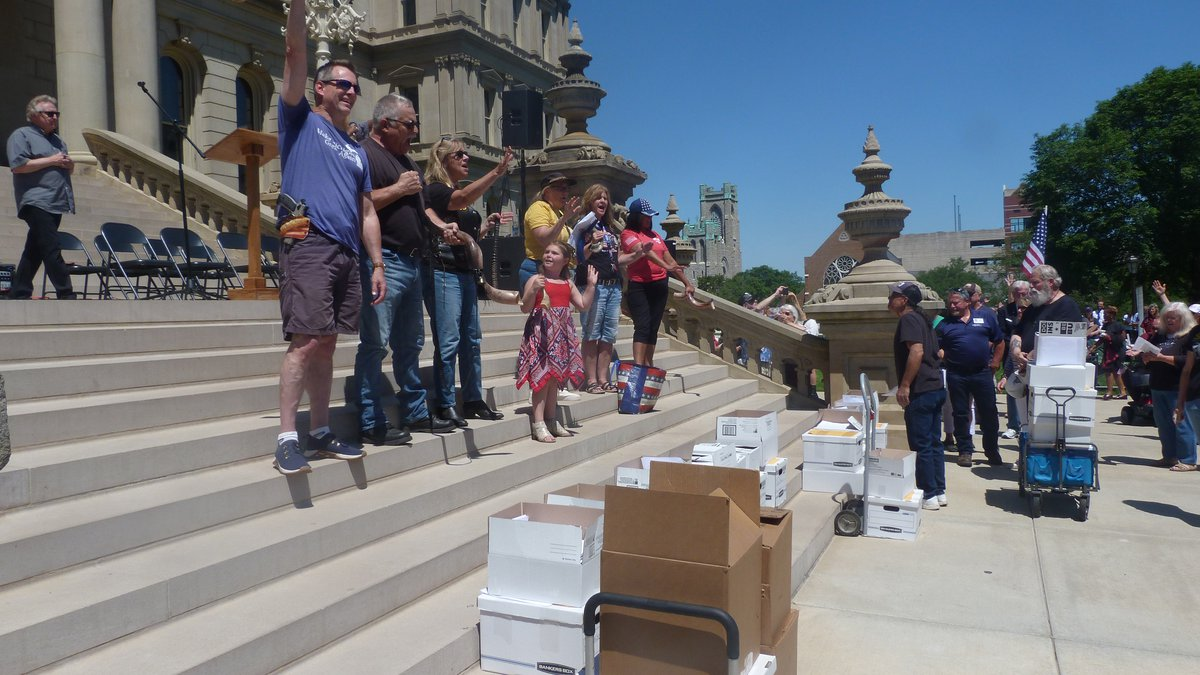 FILE - In this June 17, 2021 file photo, conservatives gather on the steps of the Michigan...